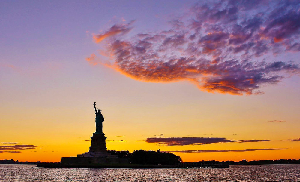 statue of liberty witnessing a beautiful sunset. photo: daniel mirkov