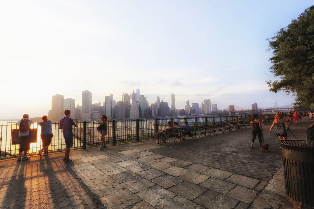 watching the sunset from the brooklyn heights promenade is a one-of-a-kind experience. there's always a jazz musician playing at the spot, making it even more remarkable. photo by lucas compan.