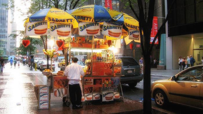 the classic hot dog cart in midtown manhattan. photo by lucas compan