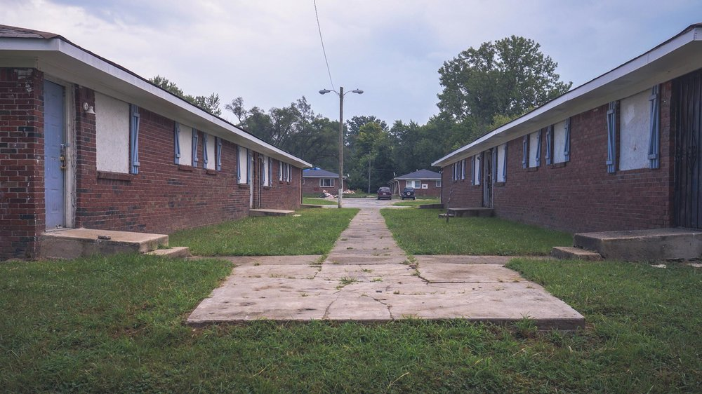 2 + 1 + 2 - 2 active housing units. 1 housing unit ready for rehabilitation. 2 vacant lots ready for development.