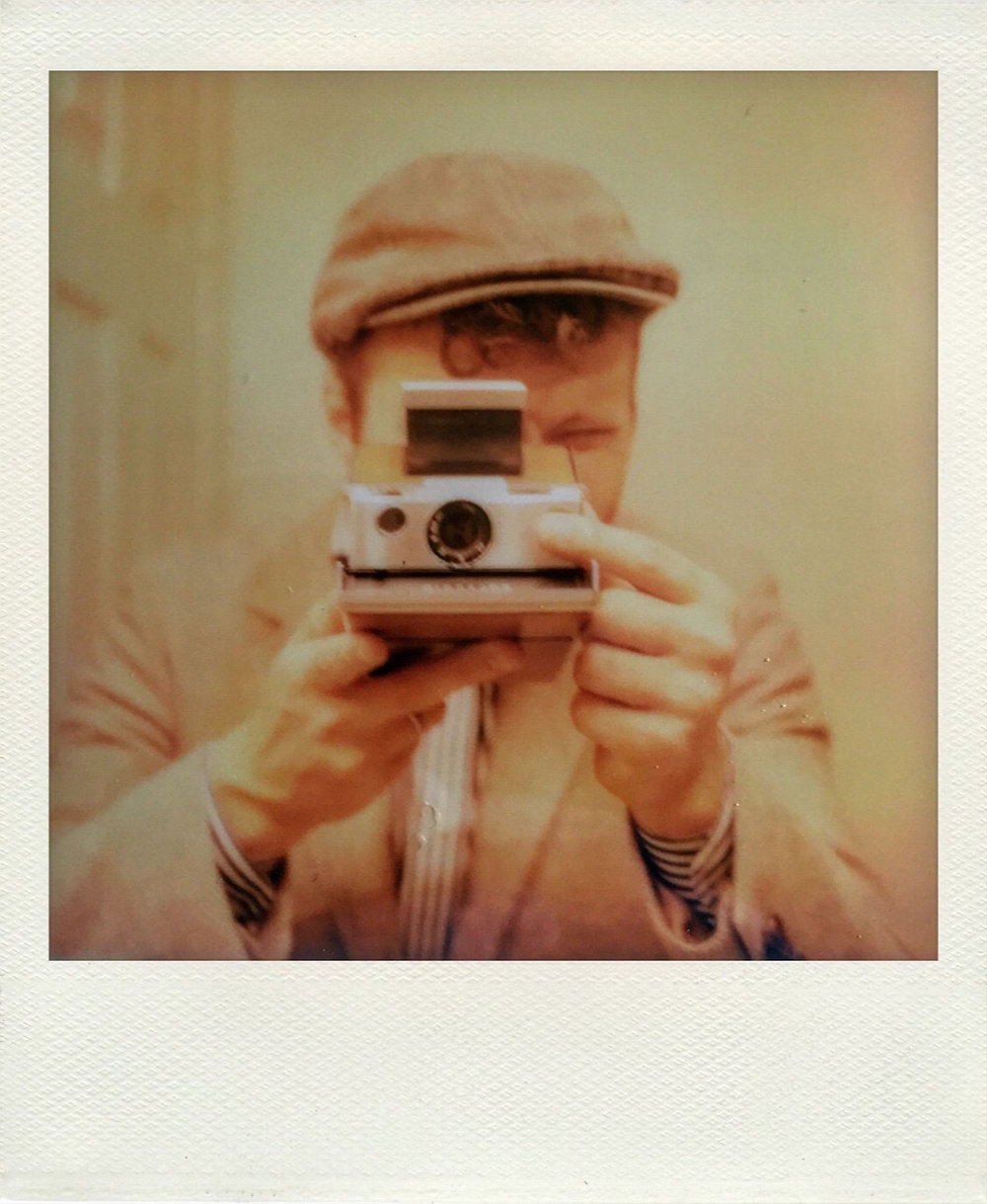 Mirror-selfie with my Polaroid SX-70 and Impossible Project film.