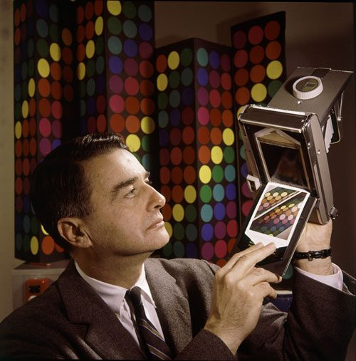 Dr. Edwin land shows off a previous Polaroid model.