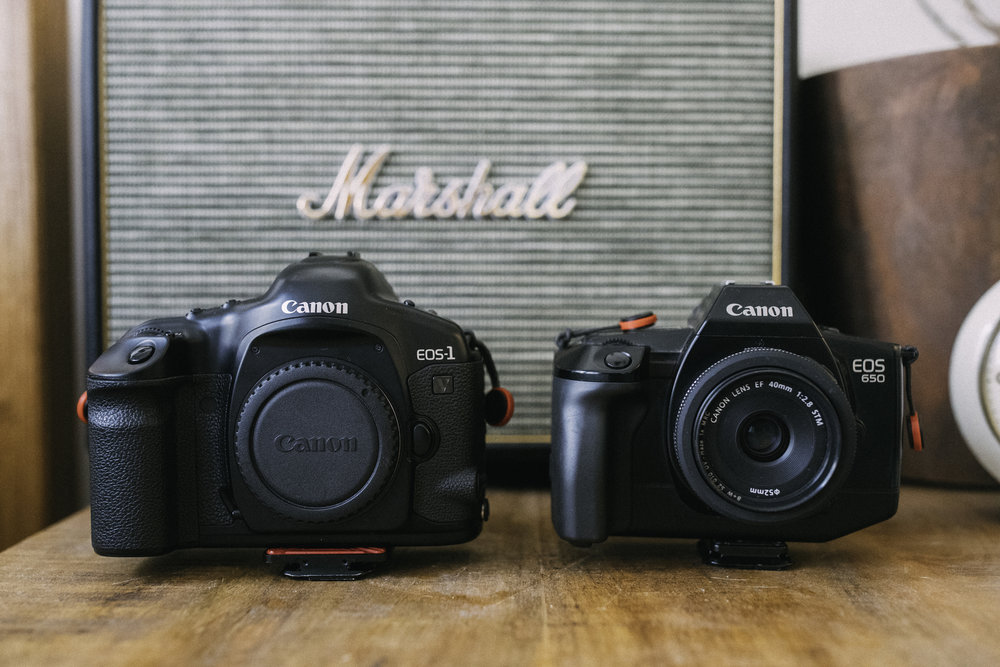 On the left sits the Canon 1V, my EOS SLR of choice, and a robust tank. The 650 is smaller and not quite as robust, but still stands up to the daily grind.