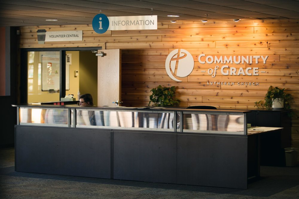 Branded reception desk wall at Community of Grace