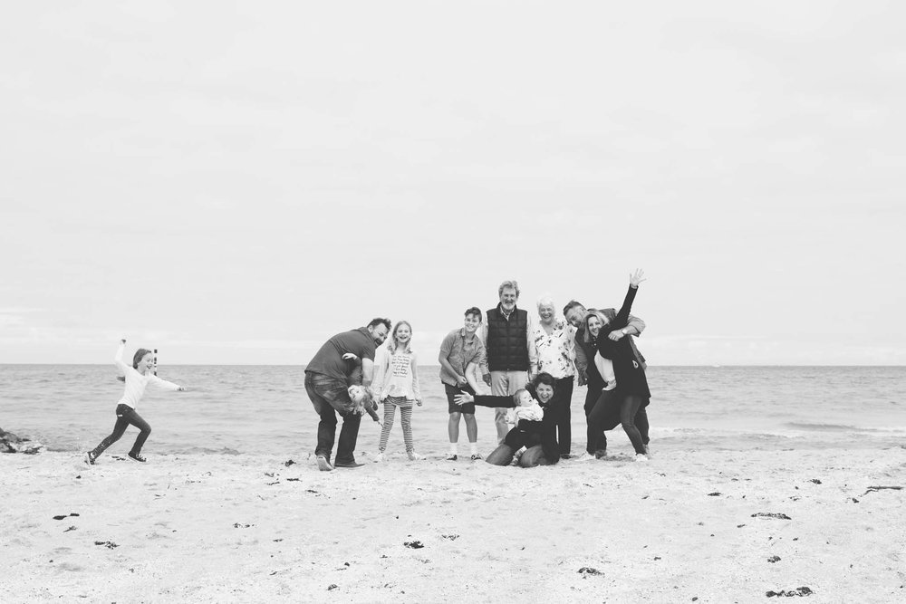 Beach photo of family in black and white