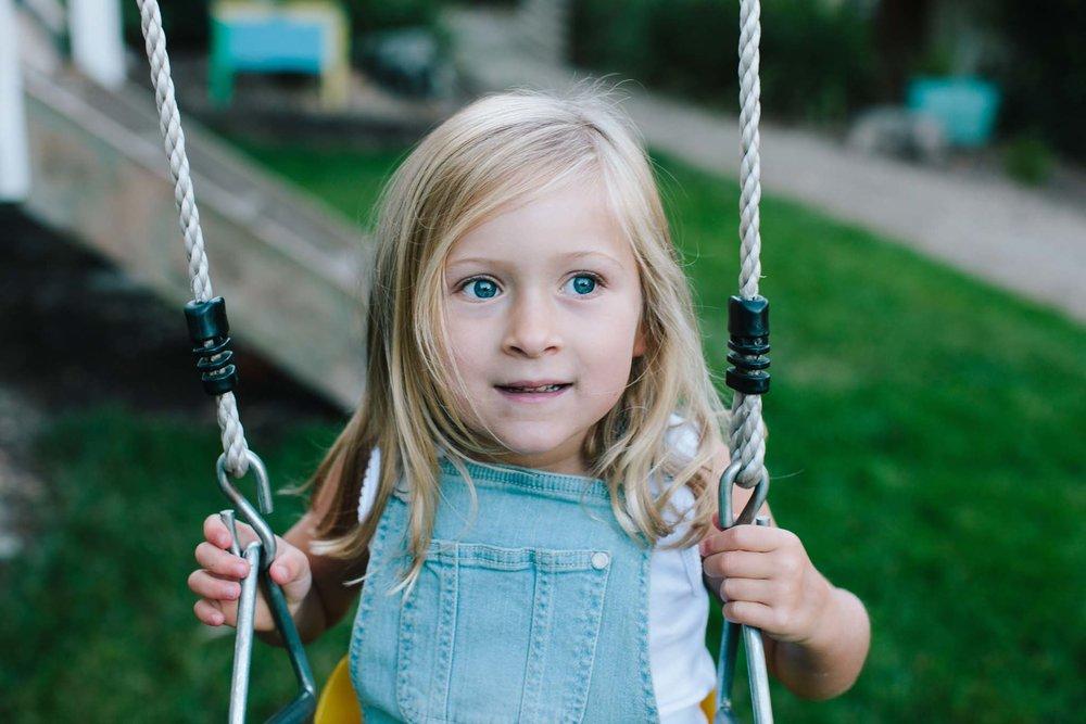 Blue-eyed girl on swings