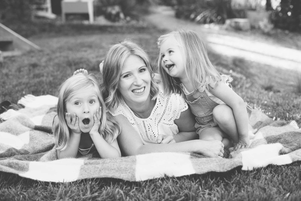 Mother and daughters in black and white