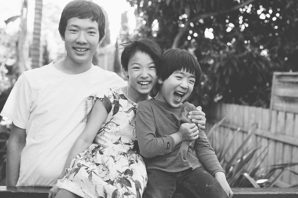 Fun black and white sibling photo