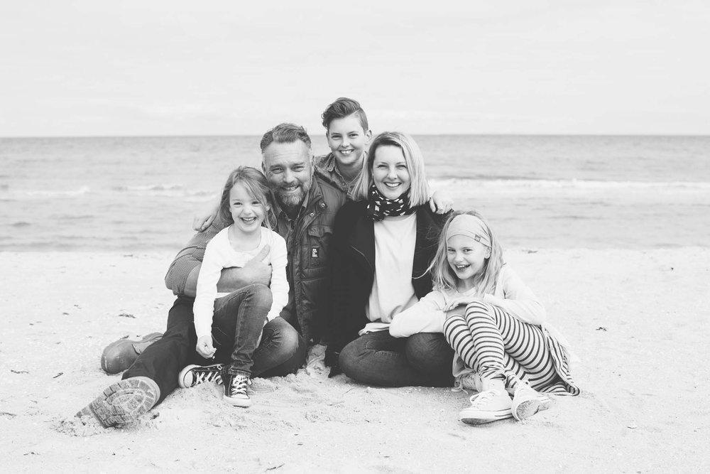 Tasteful family portrait on beach