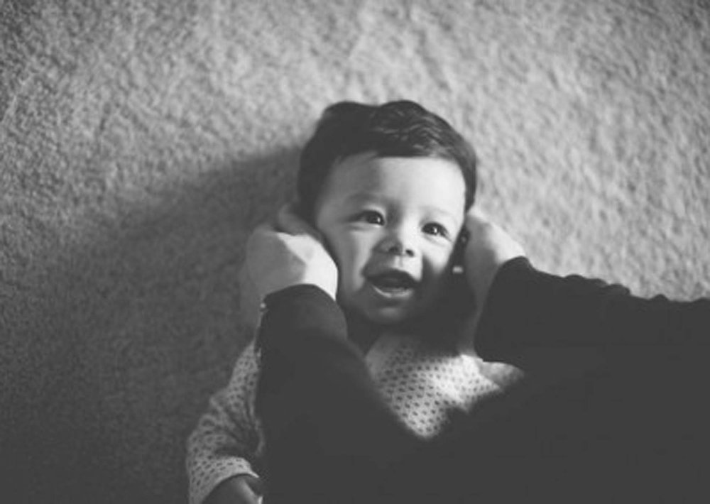 Playing with baby in black and white