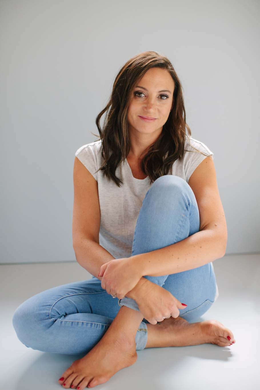 woman sitting in jeans
