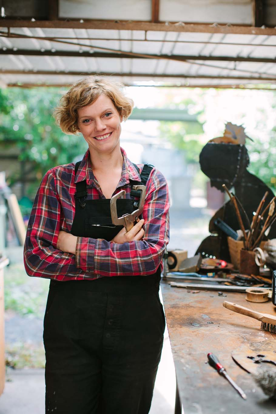 Professional business photo of woman in workshop