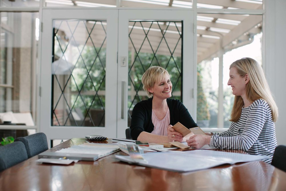 Woman speaking to new corporate employee
