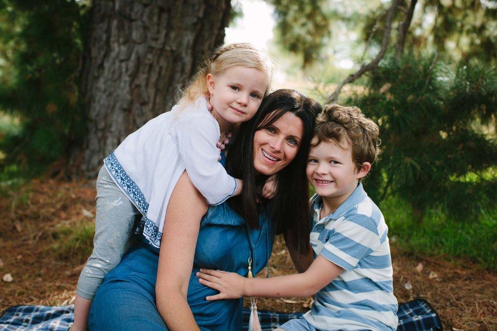 Mum and kids in fun outdoor shot