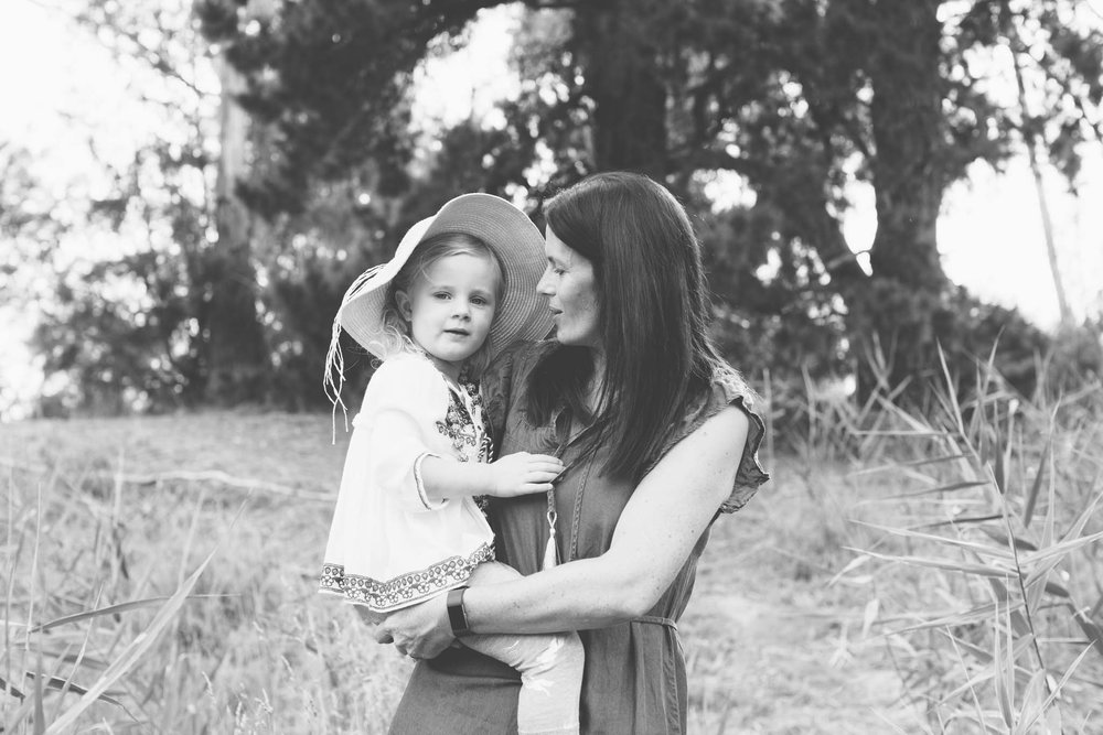 Mother and daughter black and white with baby bonnet