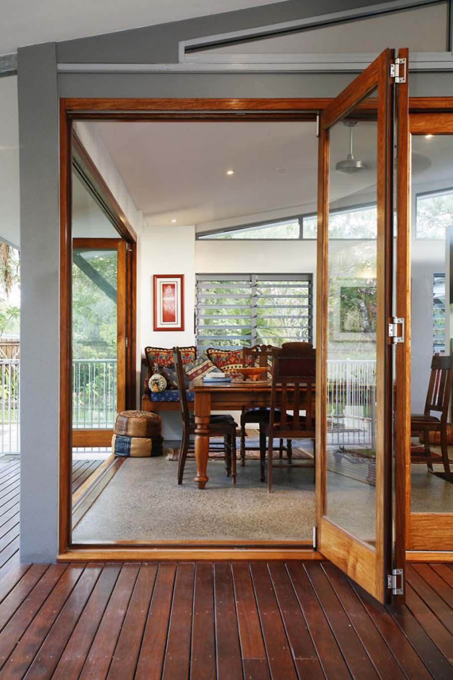 Folding door separating room opens to reveal dining area