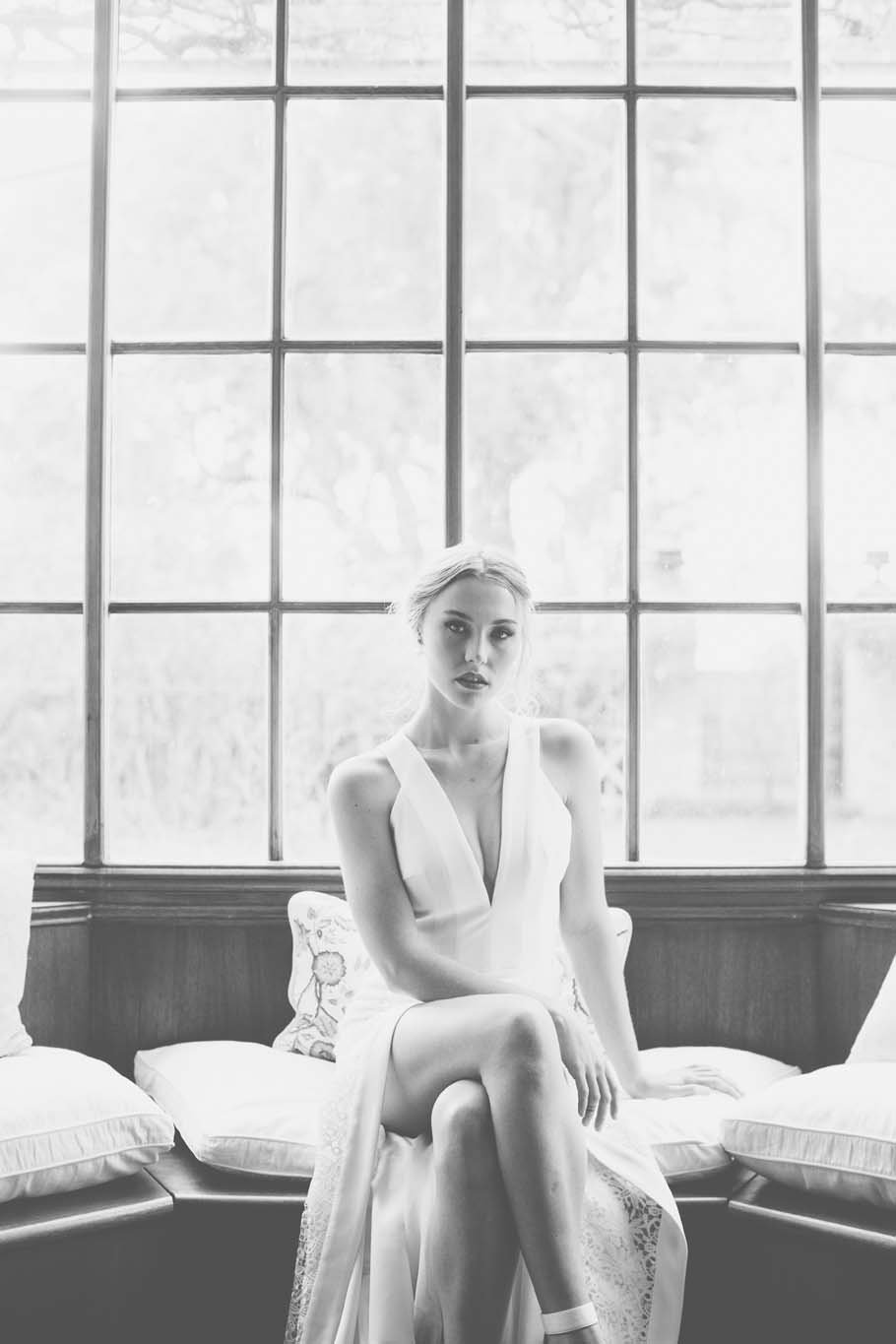 woman in front of French window in wedding dress