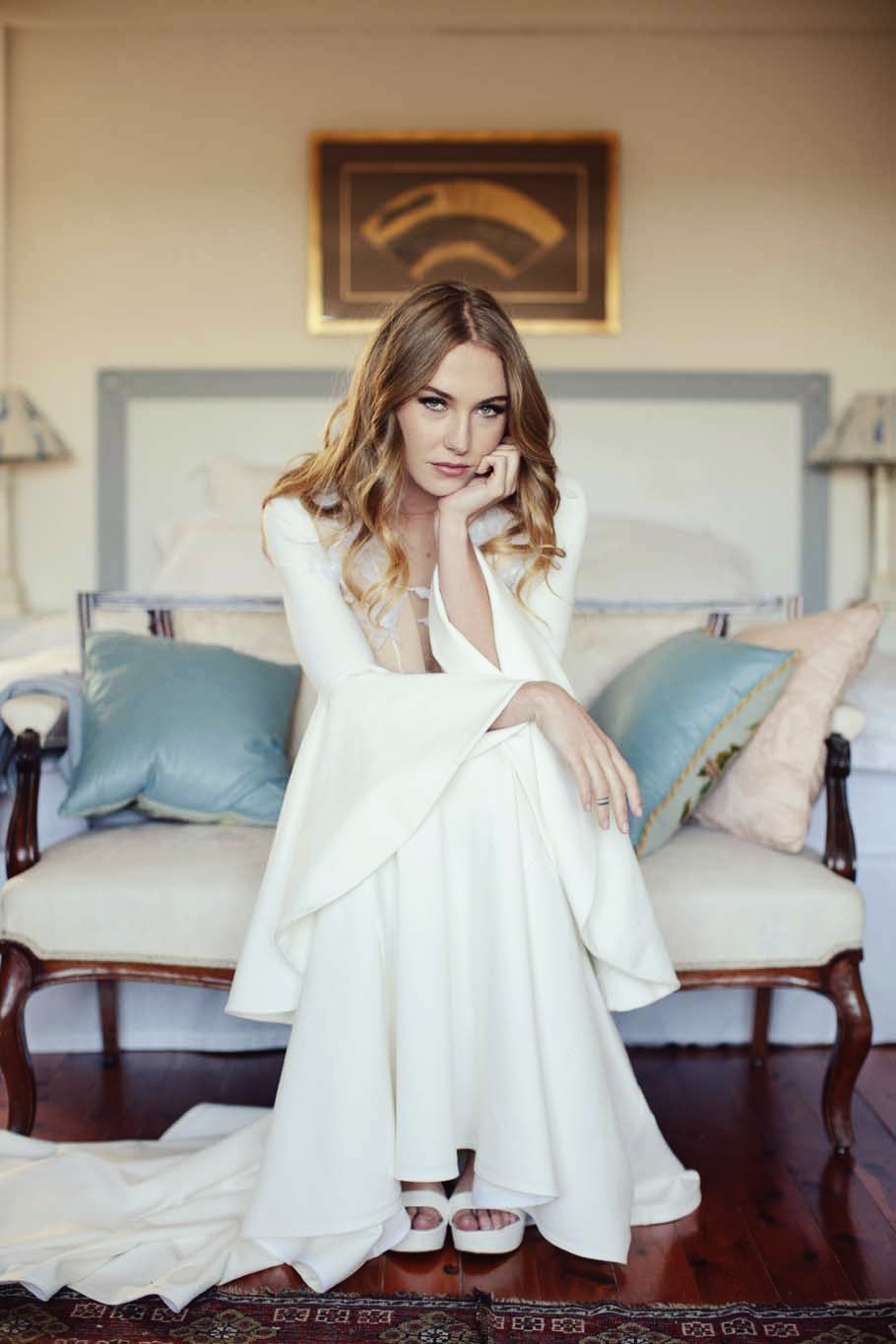 Woman in white dress with smouldering eyes