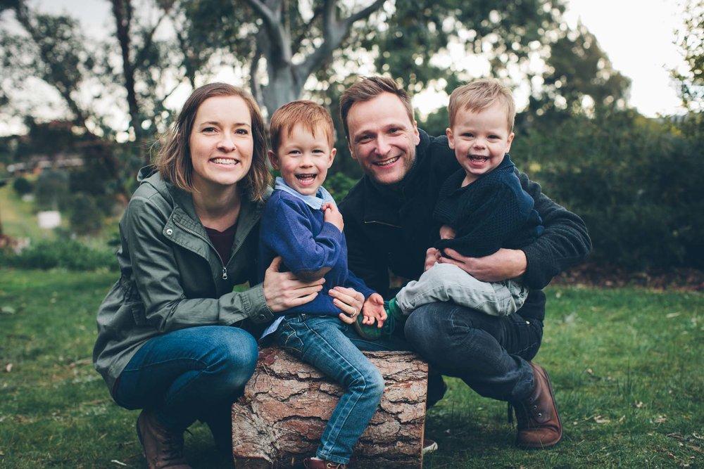 Family outdoor shot ft. log