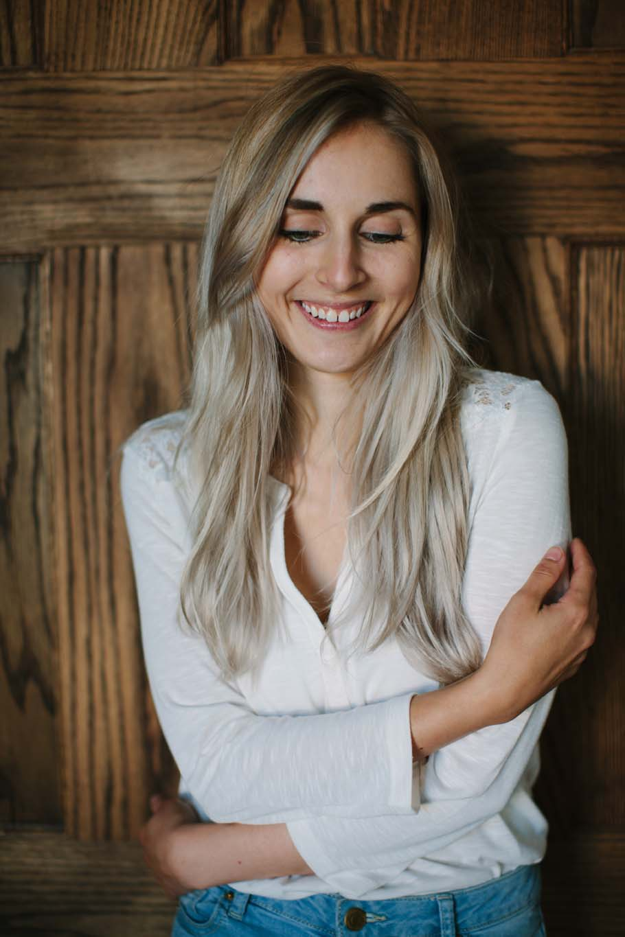 Natural shot of blonde woman against rough wood