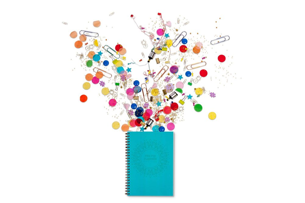 Blue spiral notepad with burst of office materials