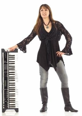The tremendous tremulous sounds that emanate from Sandy's fingers have to be heard to be believed, and, she also sings like an angel with attitude. She is kind to drummers and sound engineers too. -