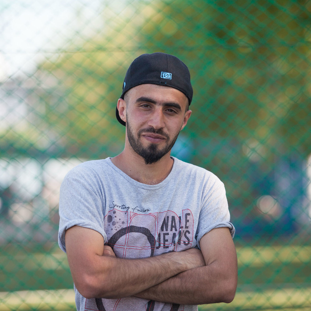 "Mohammed, 23, Iraq   What does football mean to you?   ""Everything. I played street football in my home country and my favourite team is Barcelona."""