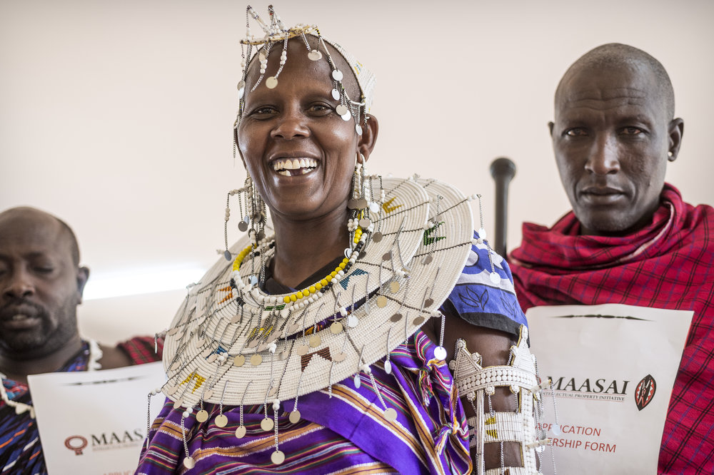 Maasai Mama receiving training certificate at our training in Tanzania