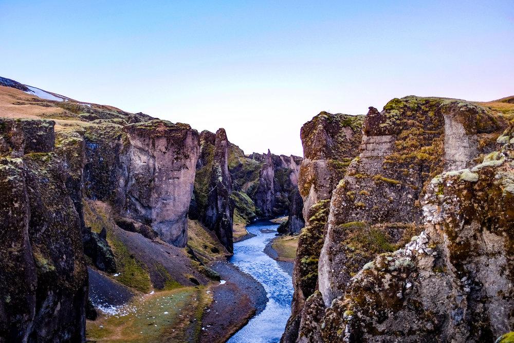 Fjaðrá river flowing through it