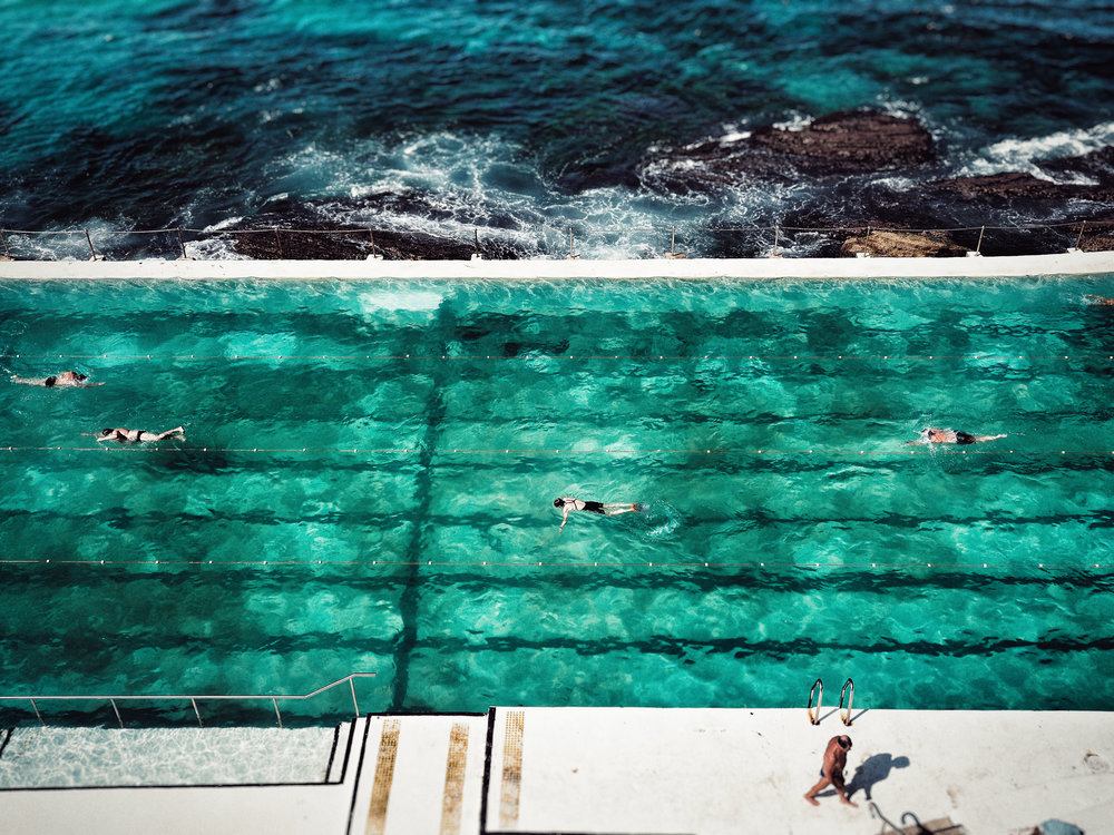 Swimmers cool off in the pool at Icebergs at Bondi Beach, Sydney, Australia