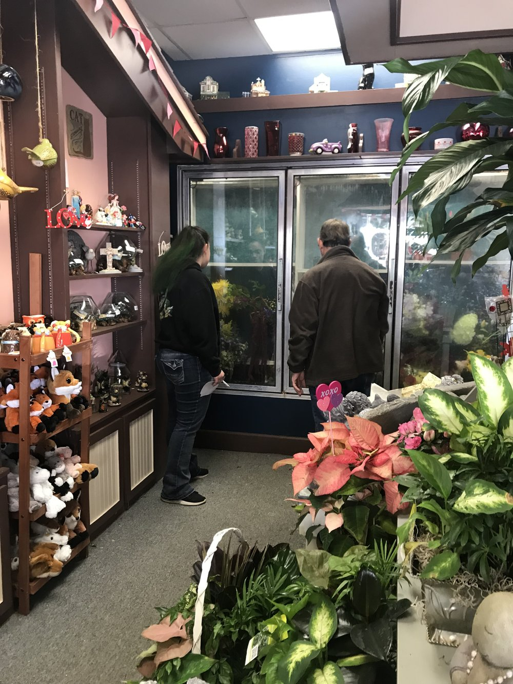 Katy Konop (left) and University of Illinois Extension educator Richard Hentschel check the inventory at Katy's floral shop