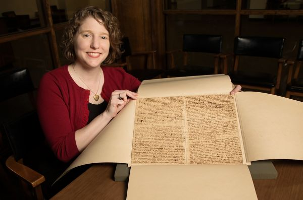 U of I Rare Book & Manuscript Library Director Lynne Thomas poses with pages from a manuscript written by English scientist Isaac Newton, which the university recently acquired at auction. (Photo courtesy of L. Brian Stauffer/University of Illinois News Bureau