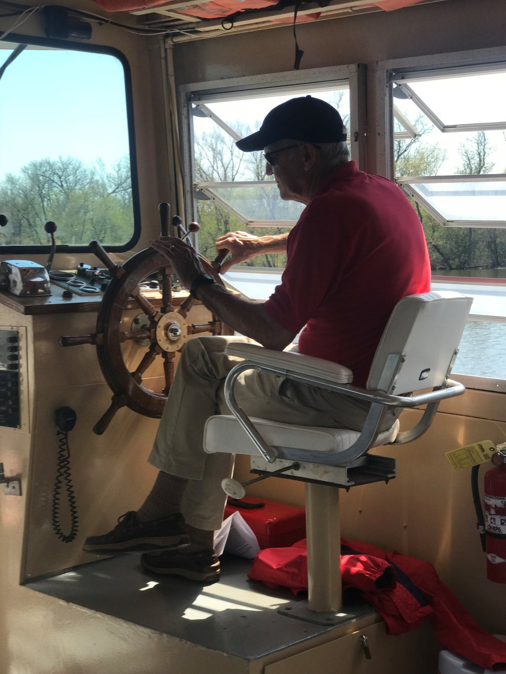 Captain Rich Anderson at the helm for his 32nd year of running paddle wheel boat tours on the Fox River