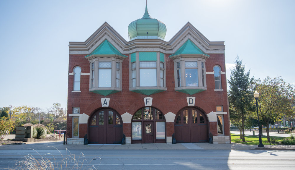 The distinctive green dome and keyhole windows are signature features of the one time firehouse that now serves as the home for the Aurora Regional Fire Museum (image courtesy of the Aurora Regional Fire Museum)