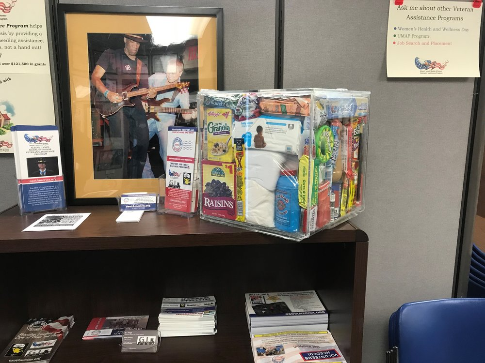 A clear mock-up of an Operation Support Our Troops care package box illustrates just how much the group is able to pack into one cubic foot of space
