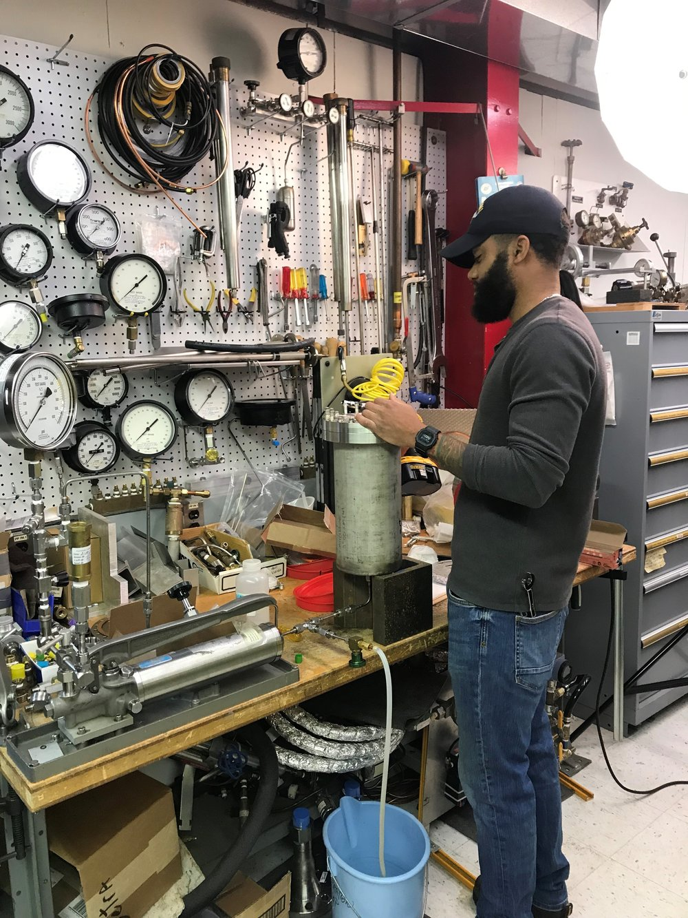 US Navy veteran Frederick Davis went from maintaining diesel engines on a ship to working on particle accelerator components at Fermi thanks to a internship program