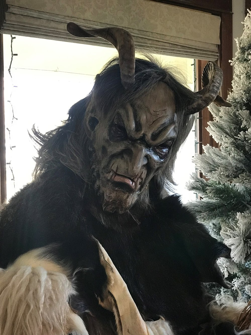 Andrew Skic portrays Krampus, the ancient central European half goat, half demon who punishes naughty children at Christmas