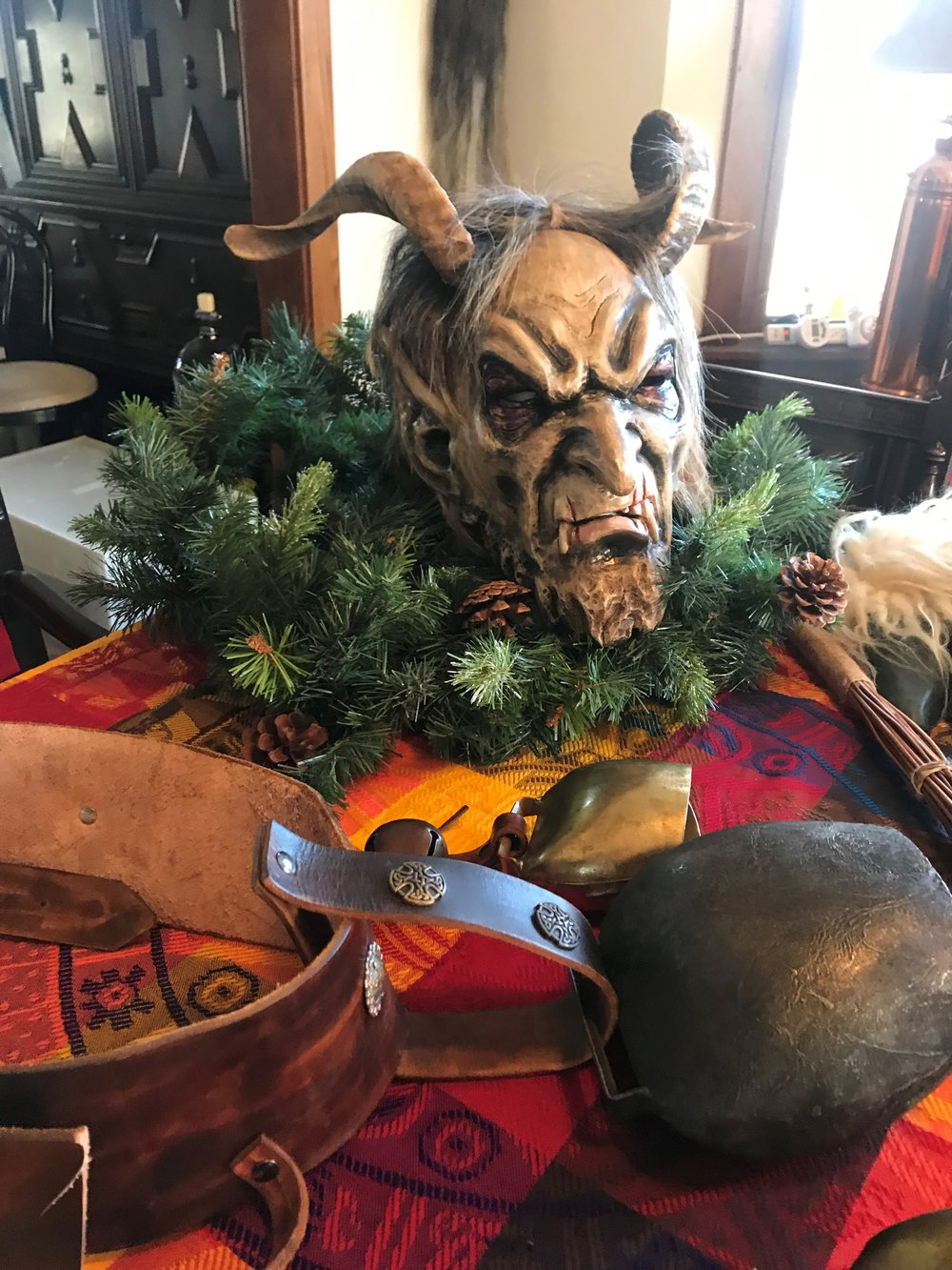 Andrew Skic's handmade Krampus mask sits on the dining room table of his Des Plaines home