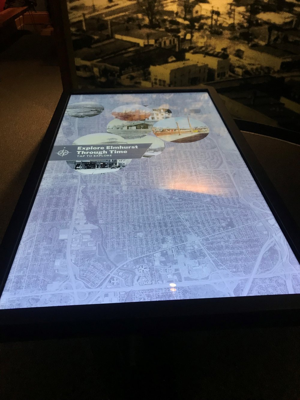 Interactive map table lets Elmhurst History Museum visitors view the city's growth through the decades