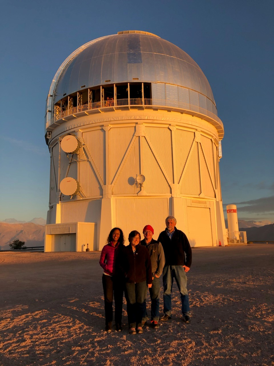 Dark Energy researchers Brenna Flaugher and Tom Diehl (center) outside the observatory in Chile