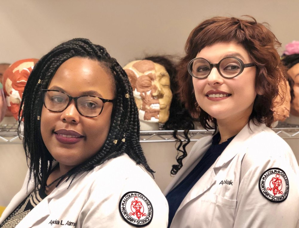 Alycia Adams (left) and Anna Wolak, students in mortuary science, stand in the restorative arts lab, with a few practice skulls. (photo courtesy of  Dusty Rhodes /WUIS)