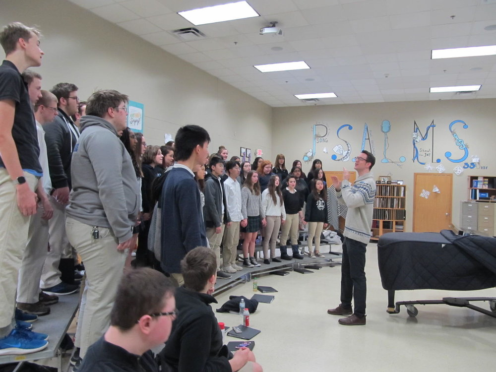 Rockford Christian School Choir Director Andy Bruhn rehearses his high school group.  (photo courtesy of Guy Stephens/WNIJ)