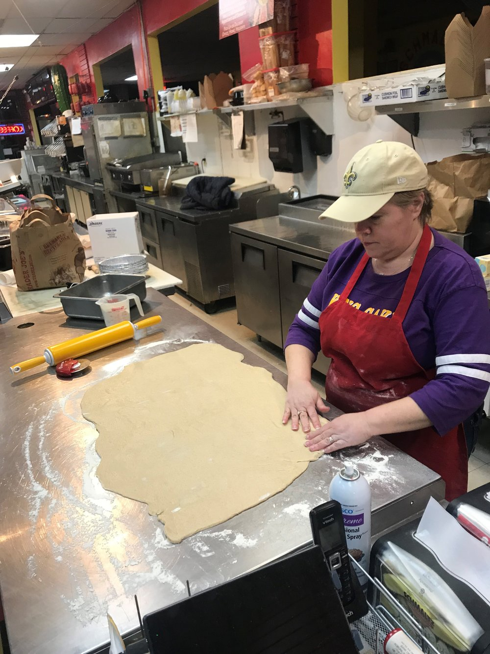 Kristen McCann rolls out the dough for an extra large King Cake during a recent night of baking