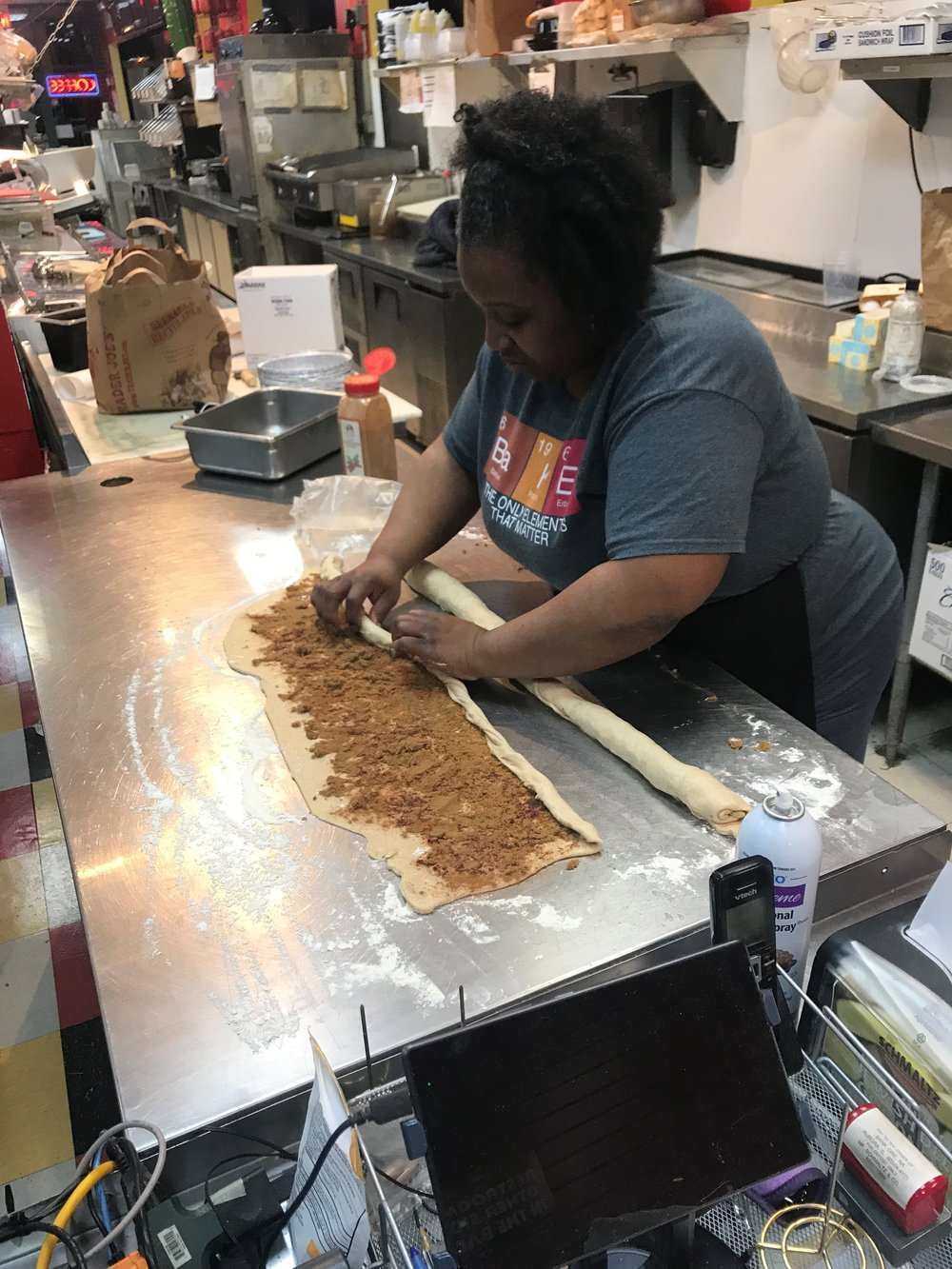Cheryl Bowman rolls the dough into a rope and then twists two together to create the ring of King Cake