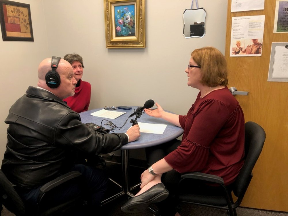 First Light host Brian O'Keefe (left) speaks with Riverwalk Adult Day Services Executive Director Jennifer Brasfield (right) and RADS Board President Marian Stricker (center)