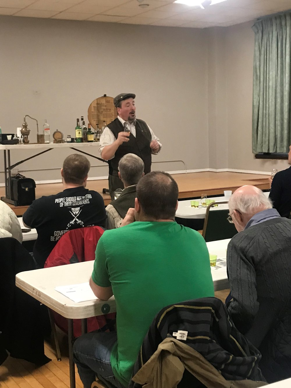 Whiskey enthusiast and historian Martin Duffy leads a class on the history, production and flavor of Irish Whiskey at the Irish American Heritage Center in Chicago