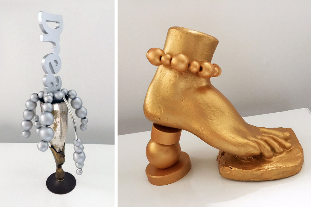 "Champagne dream, wood, iron, 14"" x 5"" x 3""                            Gold Foot, wood, plaster, 10"" x 9"" x 5"""