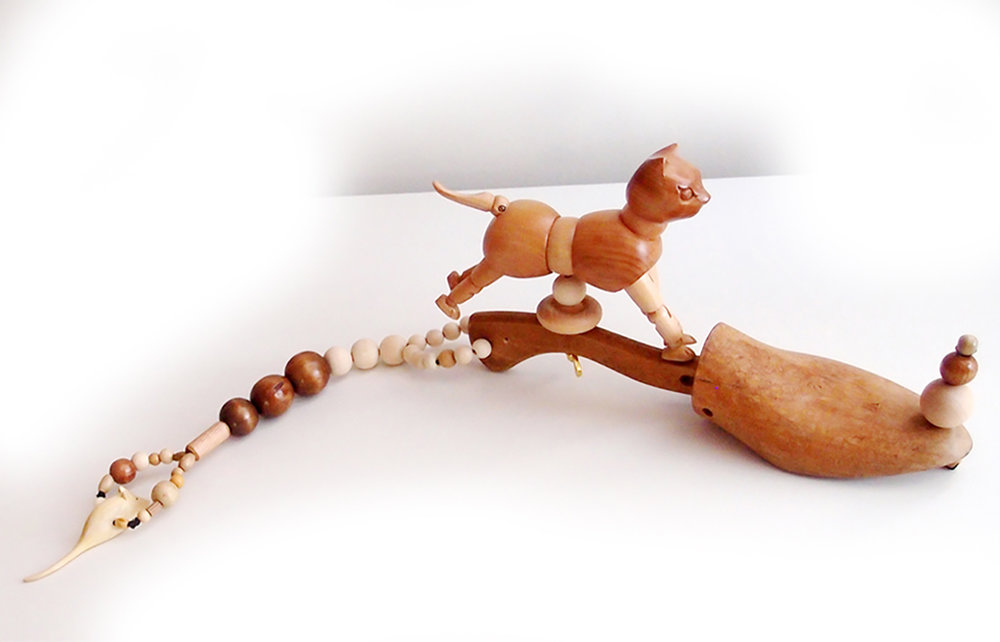 "a cat on a shoe tree, wood, 24"" x 5"" x 4"""