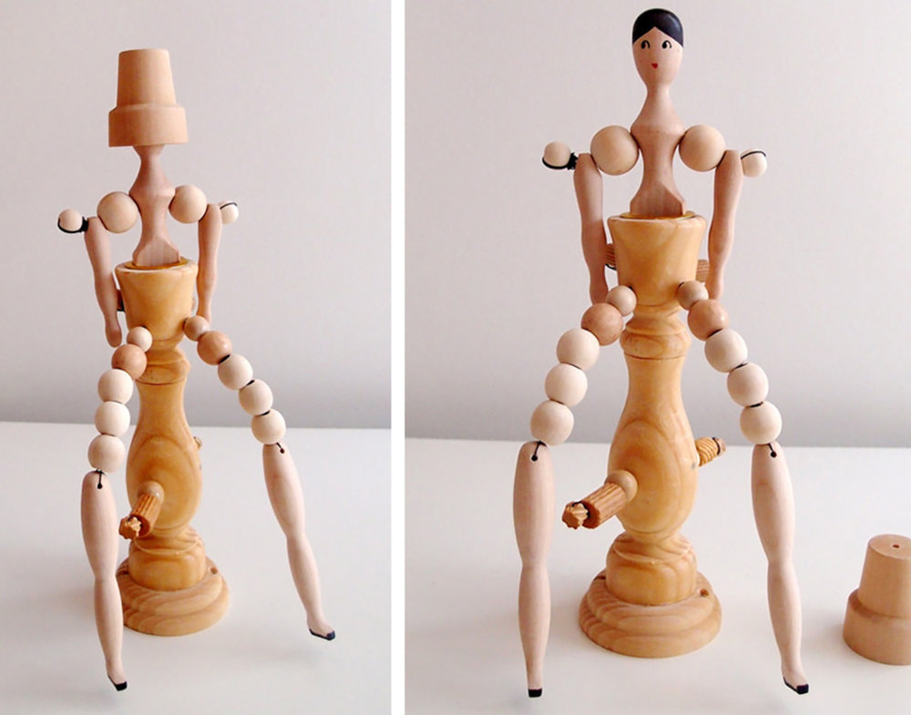 "Candle stick with a woman with long legs, wood, 11"" x 5"" x 4"""