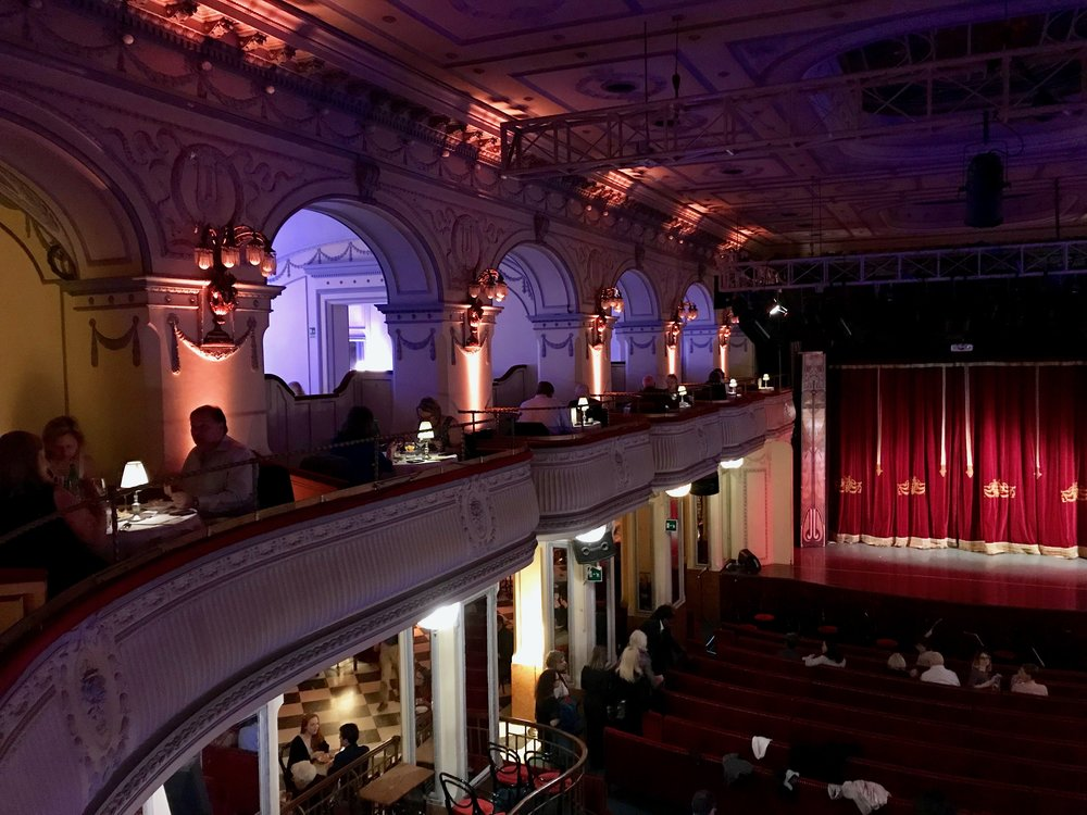 Upper-level box seats with gourmet dinner served during the show
